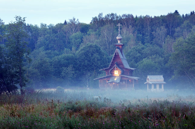 Small wooden orthodox church in the twilight